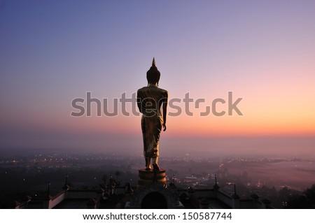 Buddha standing on a mountain  Nan Province, Thailand  - stock photo
