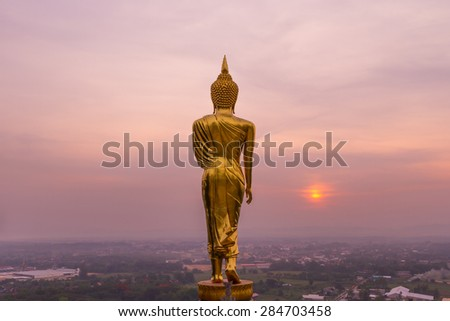 Buddha standing on a mountain Wat Phra That Khao Noi, Nan Province, Thailand