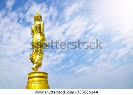 Buddha standing,Wat Phra That Khao Noi, Nan Province, Thailand, Flare light from the sun shines - stock photo