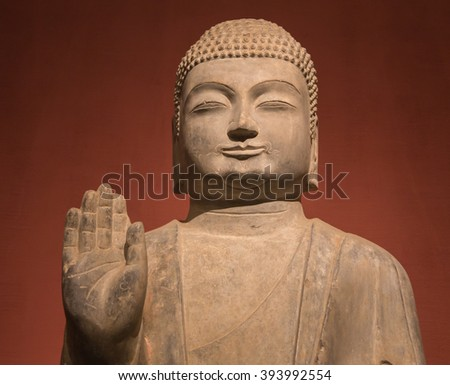 Buddha statue and candlelight