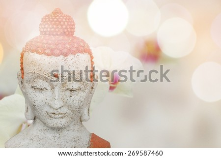 Buddha statue and orchid flower  - stock photo