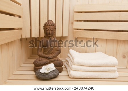 buddha statue and zen stones in sauna, relaxation background - stock photo