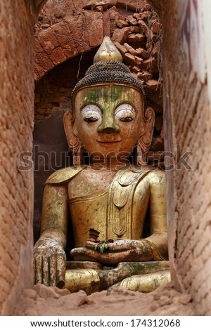 Buddha statue at a ancient temple, Myanmar  - stock photo
