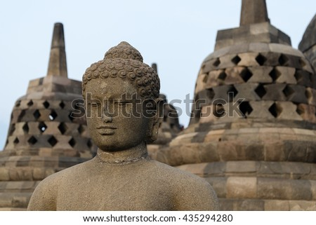 Buddha Statue at Borobudur in Indonesia, Java - stock photo