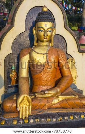 Buddha statue at the Swayambhunath Temple in Kathmandu, Nepal. - stock photo
