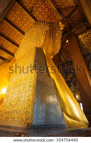 Buddha statue at Wat Pho, bangkok, thailand are public domain or treasure of Buddhism - stock photo