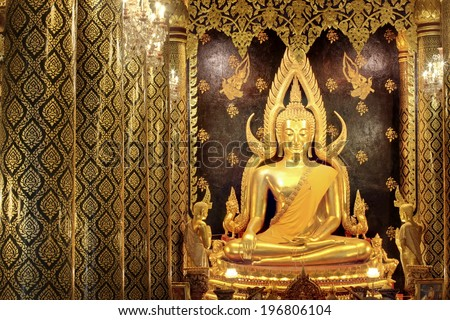 Buddha statue at Wat Prasrimahathad pitsanuloke in Thailand. Thai culture,Thai people will go to temple for pay respect to buddha statue for luck  - stock photo