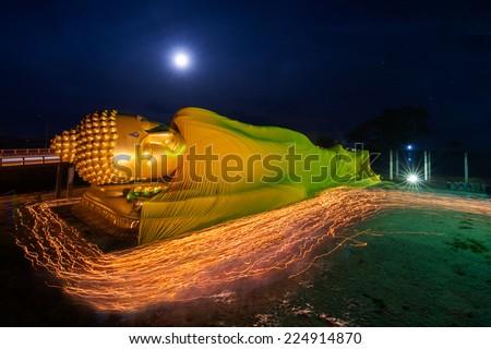 Buddha statue candle lit in vesak day thailand - stock photo