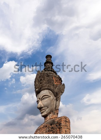 Buddha statue in hindu style and sky, Nhongkhai Province Thailand,Sala KaeoKu - Nong Khai ,Thailand,in Thailand Buddha image are public domain, no artist name or any copy right appear on the image. - stock photo