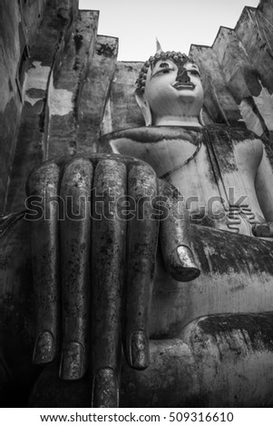 Buddha statue in Sukhothai historical park Thailand,Black and white tone