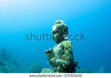 Buddha Statue in underwater Buddha temple of Tulamben, Bali, Indonesia. - stock photo