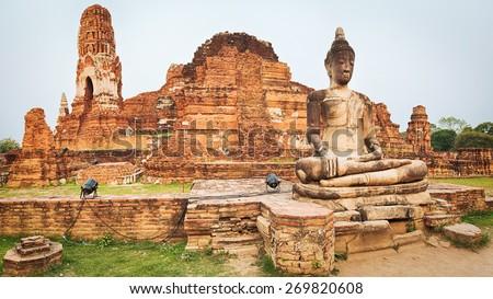 Buddha statue in Wat Mahathat. Ayutthaya historical park. Panorama - stock photo