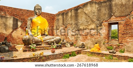Buddha statue in Wat Worachetharam. Ayutthaya historical park. Panorama - stock photo
