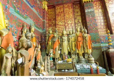 Buddha statue in Wat Xieng Thong, Buddhist temple in Luang Prabang World Heritage, Laos - stock photo