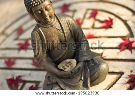 buddha statue meditating in symbol of long life - stock photo