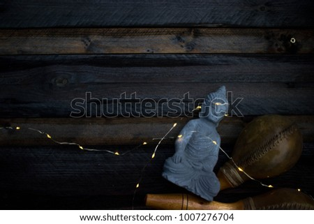 Buddha statue on a wooden table