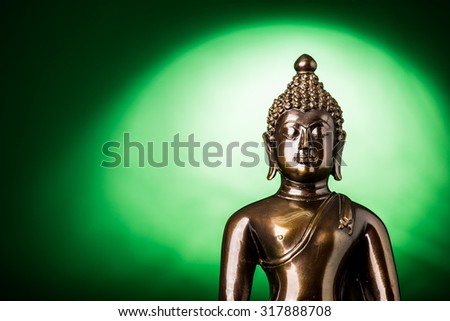 Buddha statue on green background,statue in Buddhist Thailand  temple or wat,  are public  domain  or treasure of Buddhism ,no restrict in copy or use . This photo  taken   these  conditions