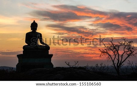 Buddha statue on sunset sky background at Saraburi, Thailand