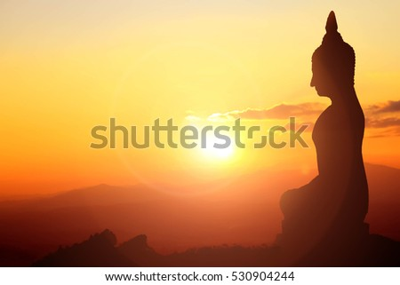 Buddha statue on sunset sky background at Thailand