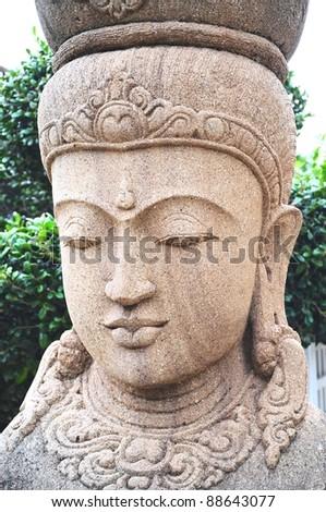Buddha statue's face close-up - stock photo