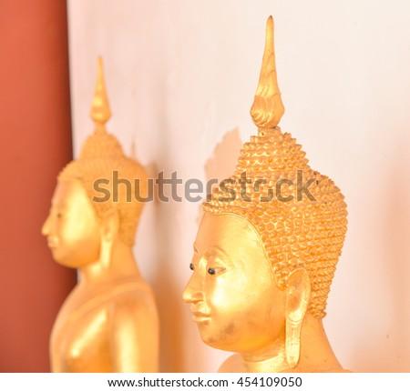Buddha Statue.The Buddhist Lent Day: The First Day of Rainy Season Retreat - stock photo