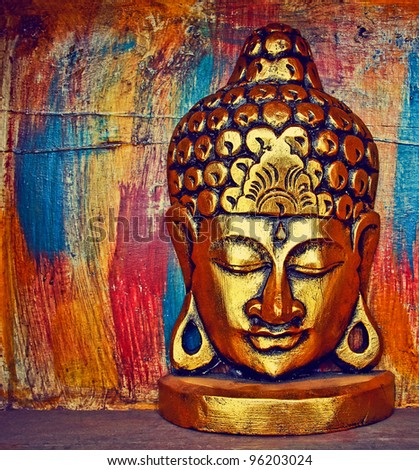 Buddha statue with glow against - stock photo