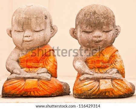 Buddha statue with plaster. - stock photo