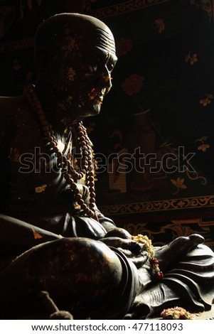 buddha statue with window light at thai temple
