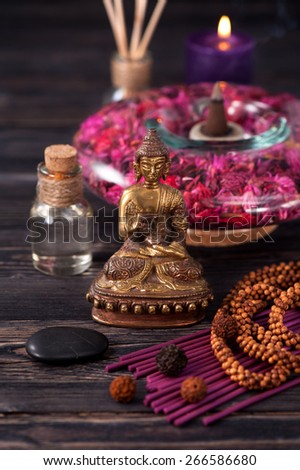 Buddha statue, zen stones and incense. concept  meditation and Zen - stock photo
