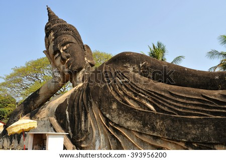 Buddha statues at the beautiful and bizarre buddha park in Vientiane/Laos. - stock photo