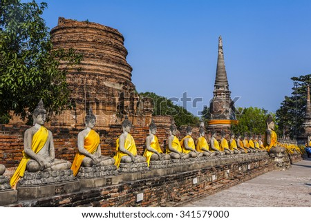 Buddha statues at the temple of Wat Yai Chai Mongkol in Ayutthaya near Bangkok, Thailand - stock photo
