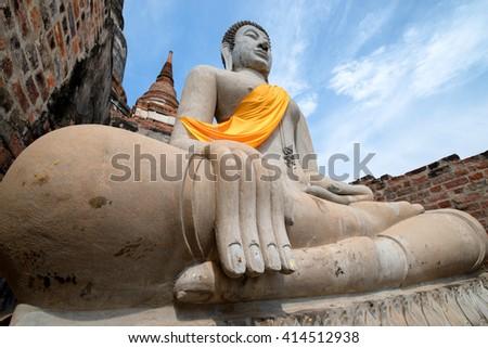 Buddha statues in Wat Yai Chai Mongkhon .Focus hand o fstatue .Famous public temple in Ayuthaya, Thailand - stock photo