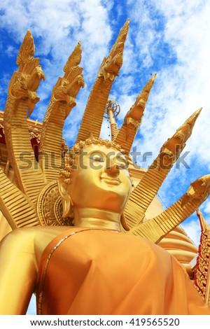 Buddha statues, large golden yellow. Against a backdrop of bright sky. Wat Khiri Wong is on his Daowadung. Muang. Nakhon Khiri Wong Temple is the holy Maha Chedi Phra Chedi Chula Manee.Thailand - stock photo