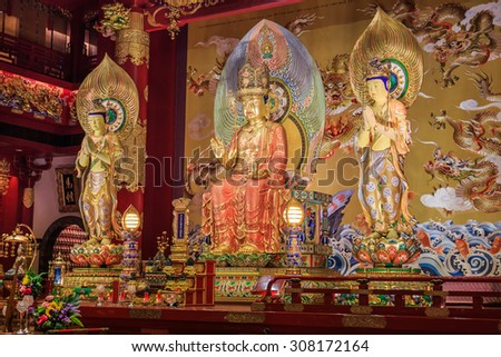 Buddha statues lined up in a monastery. - stock photo