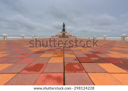 Buddha statues , patterned paving tiles , Thailand - stock photo