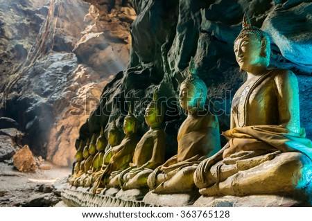 Buddha statues : The Khao Luang cave at Phetchaburi Thailand - stock photo
