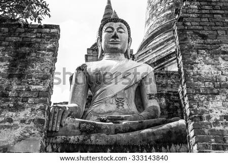 Buddha Status at Wat yai chaimongkol ,Old Temple of Ayuthaya, Thailand (black and white tone) - stock photo
