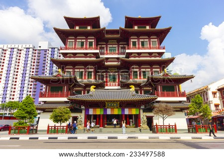 Buddha Tooth Relic Temple in China Town Singapore Singapore - October 26, 2014: The temple is based on the Tang dynasty architectural style and built to house the tooth relic of the historical Buddha. - stock photo