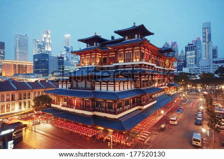Buddha Toothe Relic Temple in Chinatown in Singapore, with Singapore`s business district in the background.  - stock photo