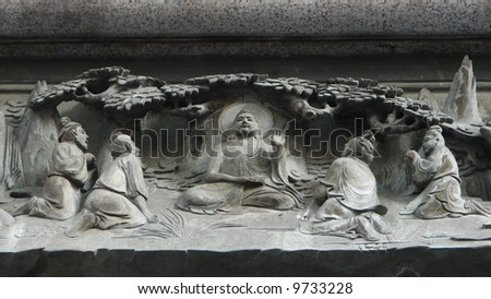 buddha with disciples under a bodhi tree relief sculpture - stock photo
