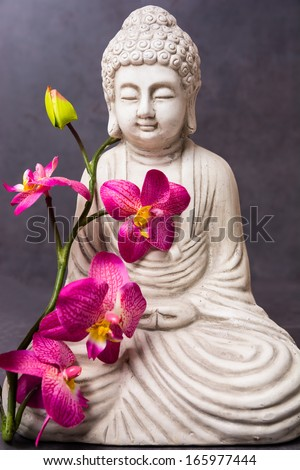 Buddha with orchid - stock photo