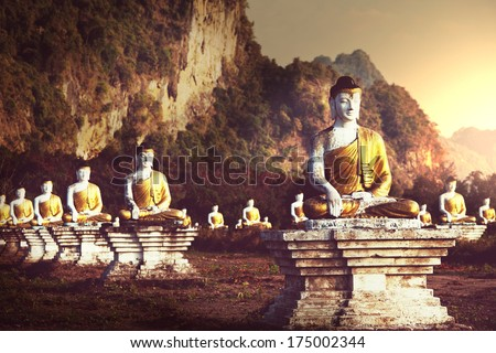 Buddhas statue garden - stock photo