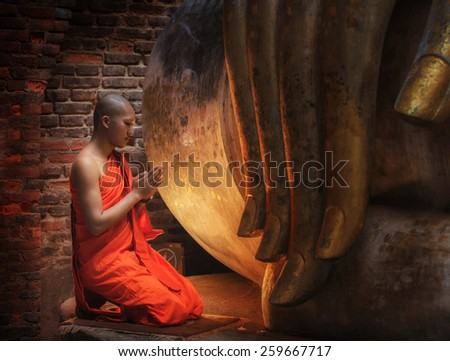Buddhism Monk sit in the Temple in Thailand.