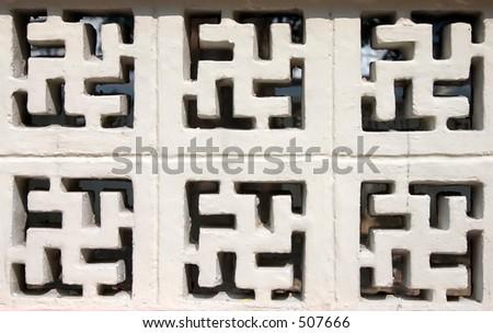 Buddhism Sign Brick Texture - stock photo