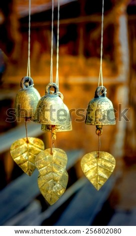 buddhism symbol in a temple....golden little bells - stock photo