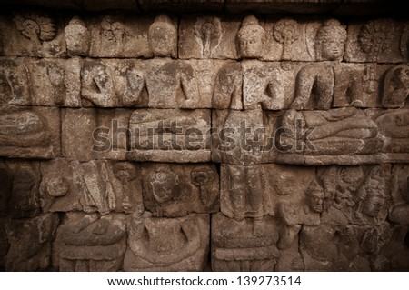Buddhist bas-relief detail whit charriot in borobudur temple site