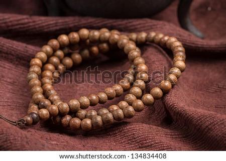 Buddhist beads, placed on the linoleum. - stock photo