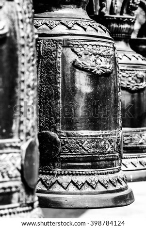 Buddhist bell around stupa, Thailand. Black and white photo.