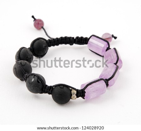 Buddhist bracelet shamballa on a white background. - stock photo