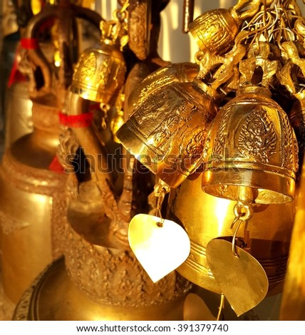 Buddhist brass bell  in thai temple - stock photo